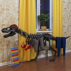 So many things going on here...thermosaurus radiator, omg....mushroom wallpaper, omg....and some sort of xylophone (well, bell-kit)  thingy goin' on...wish this was a nook in my house :)