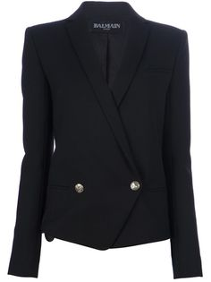 Black wool blend double breasted jacket from Balmain featuring a single contrasting gold-tone front button fastening, an asymmetrical opening, notched lapels, long sleeves with buttoned cuffs and two jetted pockets to the front.