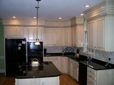 Black granite and add crown to top of cabinets.