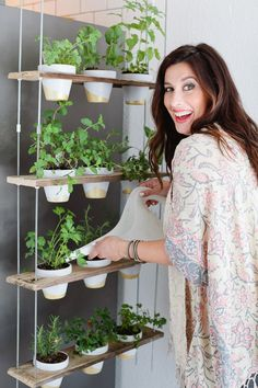 Make this Custom Potted Hanging Herb Garden. An easy DIY for your home made from pallet wood and inexpensive terra cotta pots! - Click through for the full tutorial. diy home plants Custom Potted Hanging Herb Garden DIY Hanging Herb Gardens, Hanging Herbs, Diy Hanging, Vertical Gardens, Outdoor Gardens, Diy Vertical Garden, Hanging Baskets, Culture D'herbes, Diy Herb Garden