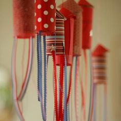 Confetti Rocket Garland or party favors with candy inside. Alternative bottom would have tissue paper glued inside & tied. If you'd rather them not hung, stick a skewer where the tie is for placing in a bucket or right in the ground outside.