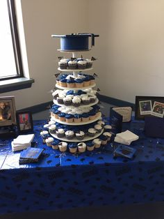 graduation cakes My sons graduation cake/cupcake display 2015 Bridal Jewelry - The Graduation Party Planning, Graduation Party Themes, College Graduation Parties, Graduation Cupcakes, Graduation Celebration, Graduation Decorations, Graduation Party Decor, Grad Parties, Graduation Gifts