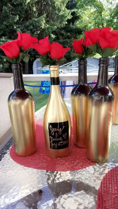 Wedding Decorative Bottles : Black and gold ombre, spray painted wine bottles. These were used as cake table decorations for a 50th anniversary party. Would also make nice centerpieces. Quick and easy to make! Make sure you coat the wine bottles with rubbing alcohol before painting. ... - #DecorativeBottles
