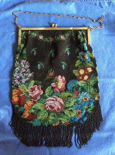"""Antique Micro Tiny Glass Beaded Purse Pocketbook Flowers. Black micro beads with floral garden. 7.5"""" drop brass chain. 7.5"""" hand engraved design on brass frame. Great Condition ,one fringe strand missing but does not distract. 