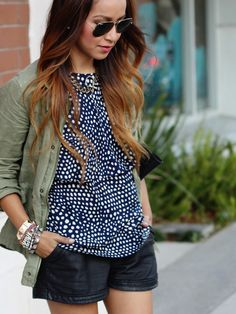 inspiration. red sleevless/tan leather shorts/military jacket.