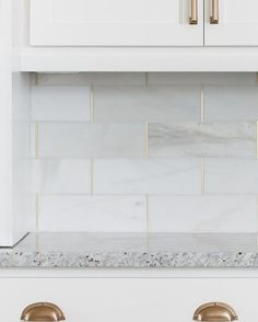 Kitchen backsplash is honed marble by the Tile Shop with brass schluter strips. Gold Kitchen, Kitchen Backsplash, Kitchen Decor, Kitchen Post, Green Kitchen, Backsplash Ideas, Beadboard Backsplash, Herringbone Backsplash, Marble Tile Backsplash