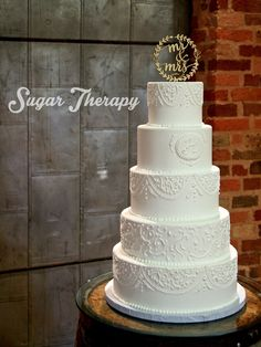 White piped wedding cake by Sugar Therapy.