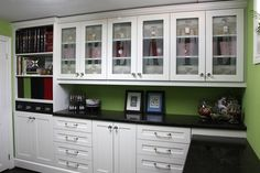 """love the """"CREATE"""" etched glass-front cabinet doors"""