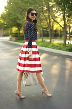 patriotic outfit. a red and white striped dress with a navy cardigan, white bag, and nude heels