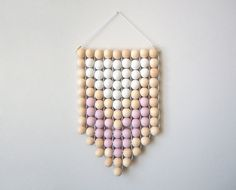 New wall hangings in dusty pastel pink look great in pairs.
