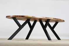 Sustainable oval table made from upcycled waste wood, The table legs are actually made from left overs from old pigs-stables. Made in Loosbroek by Herso