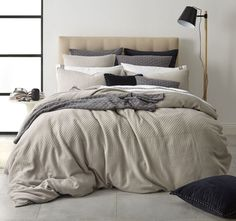 Create a pleasantly serene feel and contemporary look in your master bedroom with the Adler Linen Quilt Cover Set by Royal Doulton. This superb quilt cover set has a front panel made from a soft natural coloured polyester spandex jersey knit with panels o