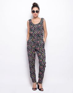 Zipped Through Jumpsuit - Floral : How awesome would laidback days be in a cool number like this! This viscose floral jumpsuit features two side pockets, elastic fit waist and a back zip closure.  Work It - Looks beyond cool with round sunglasses and wedge sandals.