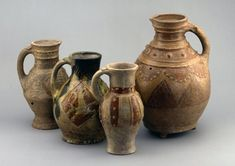 Pottery; rounded zoomorphic jug(fragment); yellow, brown and green glaze; handle of oval section with 2 applied strips at the top; body with panels each containing a dragon; highly decorated style.