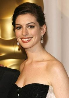 The lovely Anne Hathaway with large tear drop pearl necklace on silver base.