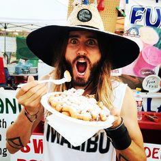 He enjoys a nice funnel cake at the county fair.