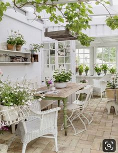 Rustic furniture complements an antique brick floor perfectly in this bright and airy garden room. Outdoor Rooms, Outdoor Gardens, Outdoor Living, Outdoor Furniture Sets, Rustic Furniture, Antique Furniture, Conservatory Ideas Interior Decor, White Wicker Patio Furniture, Conservatory Interiors