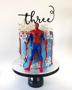 Spiderman Birthday Cake by Lottie and Belle on our black modern cake stand | Available at amalfidecor.com