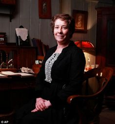 Downton housekeeper Mrs Hughes can relax in her sitting room, which has a plush velvet chair and photographs of her family