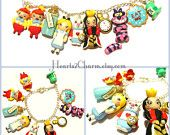 Disney's Alice In Wonderland inspired Polymer Clay Charm Bracelet. Handmade charm bracelet of Alice and memorable characters from the movie