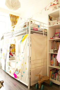 Kate's Wonderfully Small Amsterdam Space-panels added to a bunk bed frame to create a fort