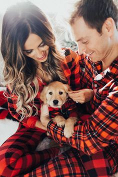 fashion blogger mia mia mine wearing plaid pajamas with husband phil thompson and golden retriever puppy luna