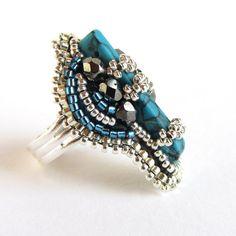 He encontrado este interesante anuncio de Etsy en https://www.etsy.com/es/listing/201061946/dramatic-and-intricate-adjustable-bead