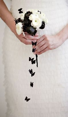 Bridal bouquet. Flowers We Love.    What a cute, tiny bouquet! I love the contrast against the white gown!    wedding bouquet with cascading butterflies