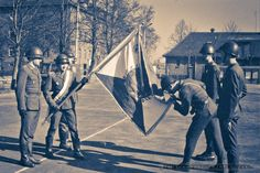 A Polish People's Army soldier of the 11th Reconnaissance Battalion (11 Batalion Rozpoznania Radioelektronicznego) kisses is banner in his oath-taking ceremony.