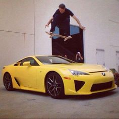 tony hawk over the lexus... i think he's the only one i would trust to jump over a nice car like that.