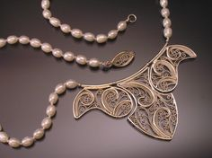 Designs by Lisa Gallagher - Jewelry, ornaments and other unique items handmade by the artist.