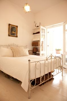 Beautiful vintage-styled white bedroom in Cape Town, South Africa.