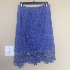 Beautiful crochet skirt from Bebe NWT Never been worn new with tags, purple blue skirt within crochet looking overlay and hidden zipper and hook. Size 8 bebe Skirts Midi