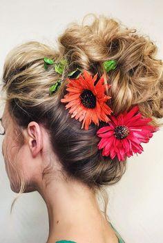 wedding hairstyles with flowers high hair bun with red flowers jane hahaeva