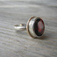 Garnet..my birthstone. Love this ring!