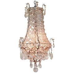Beautiful Mid-Century Crystal Chandelier | From a unique collection of antique and modern chandeliers and pendants  at http://www.1stdibs.com/furniture/lighting/chandeliers-pendant-lights/