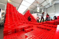 BNKR arquitetcura upcycles crates into social topography for expo CIHAC in mexico city 2014