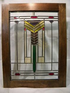 """Mission Style Stained Glass  The window depicts a stylized wheat stalk wich stands for health and prosperity. Frank Lloyd Wright used the design in several forms in many of his windows.  The clear glass is from old homes in the Seattle area. The wood frame is also from old homes. Measurements for the window are 15"""" x 21 1/4"""". With recycled Douglas Fir wood frame 19 1/2"""" x 26""""."""