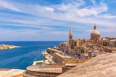 View from above of the golden domes of churches and roofs with church of Our Lady of Mount Carmel and St. Paul's Anglican Pro-Cathedral, Valletta, Capital city of Malta Best Places In Europe, Places To Travel, Cheap Family Holidays, Amazing Destinations, Travel Destinations, Cheap European Cities, Family Holiday Destinations, Alternative, Paphos
