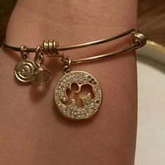 Gold plated lucky elephant trunk up bangle Gold plated trunk up lucky adjusting bangle pre owned cute missing only 5 crystal stones shown in pictures but can't tell when worn unless you look closely Jewelry Bracelets