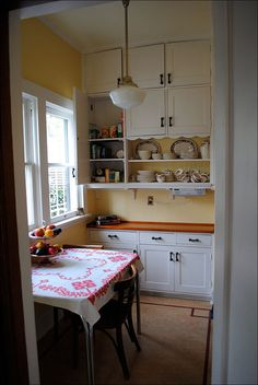 Eat in Kitchen, C. 1915 - Eat in Kitchen, C. 1915 Cute breakfast nook in this restored kitchen. The shelves and cabinets on t - Old Kitchen, Eat In Kitchen, Kitchen Redo, Vintage Kitchen, Kitchen Dining, Kitchen Remodel, 1940s Kitchen, Nice Kitchen, Kitchen Taps
