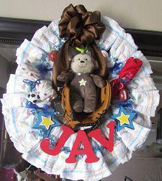Diaper wreath sports themed.