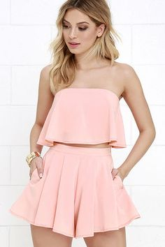 "Admirers of on-trend fashion can't help but be a little envious of you in the Squad Goals Peach Strapless Two-Piece Set! A woven strapless top with no-slip strips (and exposed silver back zipper) flutters atop matching pleated shorts. Hidden side zipper with clasp.Small top measures 7.5"" long. Small bottom measures 13"" long."