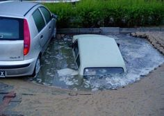 Unlucky spot  Car Disappearing In A Parking Lot Sink Hole