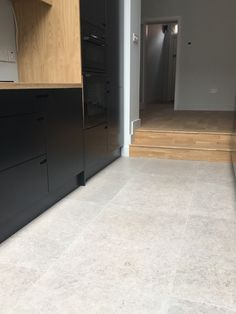 Contemporary stone lookalike 60x90cm rectified porcelain marries beautifully with a wooden floor and dark kitchen doors... happy clients!😍 #inspiration #architects #kitchenfloor #floortiles #design #interiordesigners #irishinteriordesigners #colour #contemporary #porceliantiles #italianstyle #loveyourhomeagain #smallbusiness #moderninteriors #interiordesign #interiorstyling #dunlaoghaire #luxuryhome #womeninbusiness Modern Interior, Interior Styling, Interior Design, Wooden Flooring, Kitchen Flooring, Home Again, Kitchen Doors, Italian Style, Tile Design