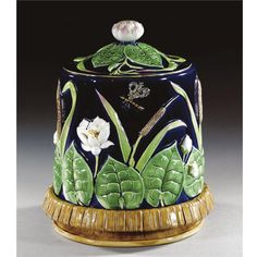 A GEORGE JONES MAJOLICA CHEESE DISH AND COVER CIRCA 1870 moulded in relief with insects amongst bulrushes and water lilies against a cobalt blue ground