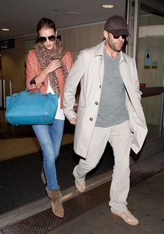 Jason Statham and Rosie Huntington Whiteley arrive at LAX (Los Angeles International Airport) hand in hand.