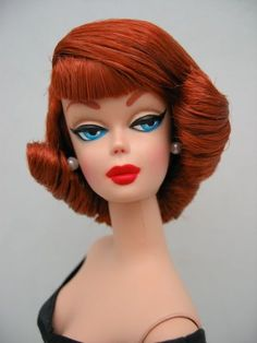 She looks like a version of Barbie, though I have no idea which.