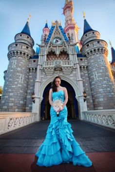 Bride in blue wedding gown in front of Cinderella's Castle at the Magic Kingdom Disney theme park