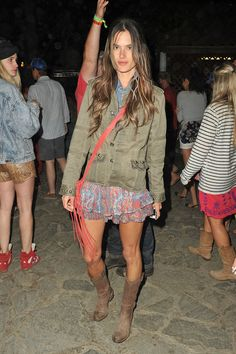 Model Alessandra Ambrosio is seen with her 'Entourage' on day three of the 'Coachella Music Festival' in Indio.